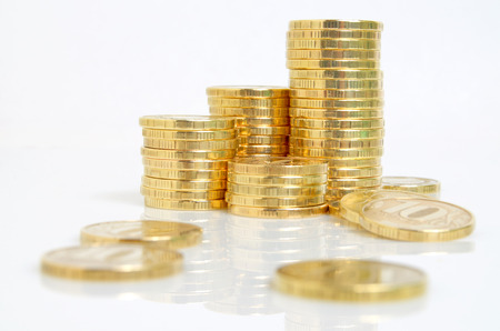 speculation: Still life with yellow coins on a white background  Stock Photo