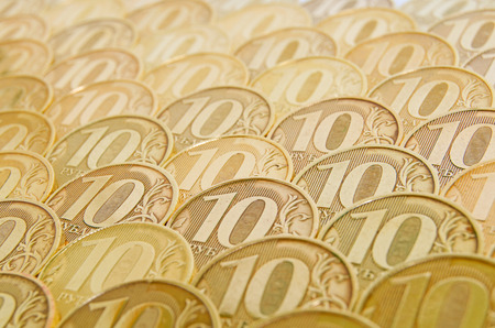 inflow: Shiny, yellow coins orderly arranged on the plane  Stock Photo