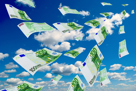 Deformed euro banknotes in flight on a blue sky background  Stock Photo