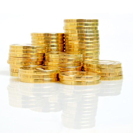 margins: Still life with yellow coins on a white background  Stock Photo