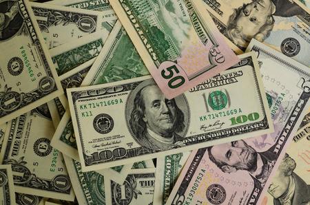 accrued: Dollar bills of various denominations in the plane. Stock Photo