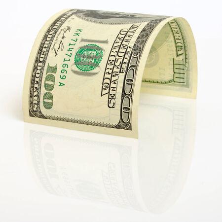 軽飛行機に湾曲した 100 ドル紙幣をクローズ アップ。 写真素材