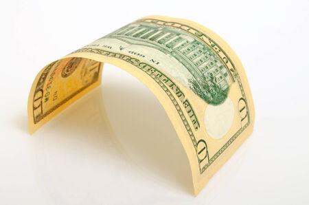 accrued: Curved bill ten dollars on a light plane. Stock Photo