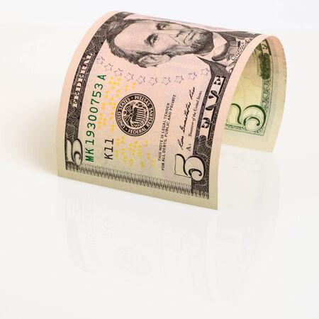 cashing: Five dollars closeup on a light plane.