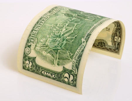 two dollar bill: Two dollars close up on a light plane. Stock Photo