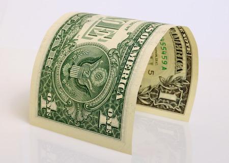 cashing: One dollar close up on a light plane. Stock Photo
