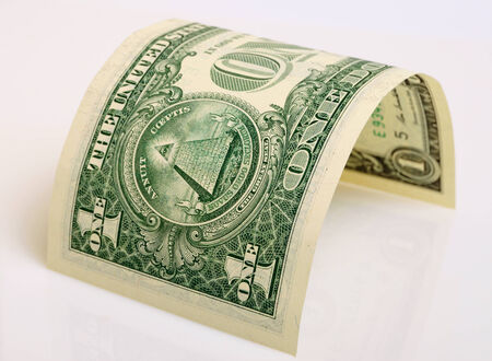 accrual: One dollar close up on a light plane. Stock Photo