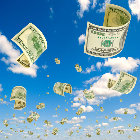 accrual: Hundred-dollar bills falling from the sky. Stock Photo