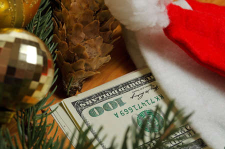 accrual: Still life with dollar bills and christmas accessories.