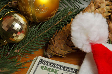 holiday budget: Still life with dollar bills and christmas accessories.