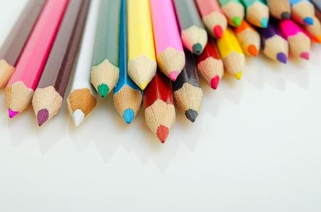 Colored pencils on a light background closeup.