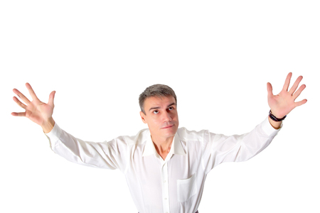 indignant: A man raises his hands to the top, isolated.
