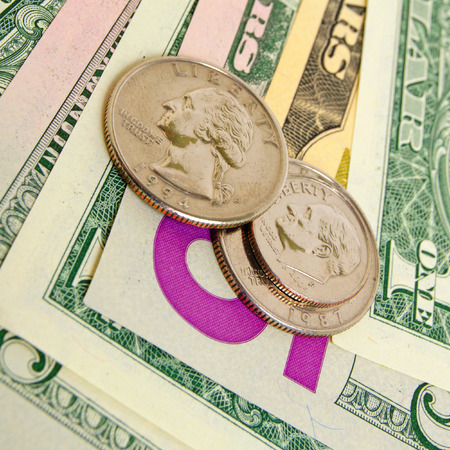cashing: Still Life with cash dollars and cents US. Stock Photo