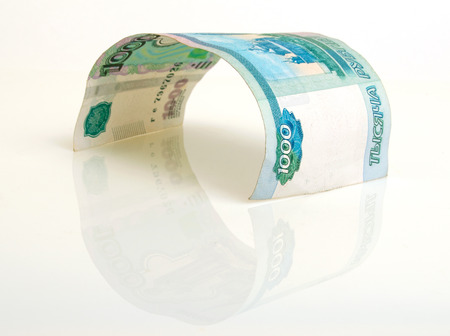 saving tips: One banknote thousand russian rubles, on a light background. Stock Photo