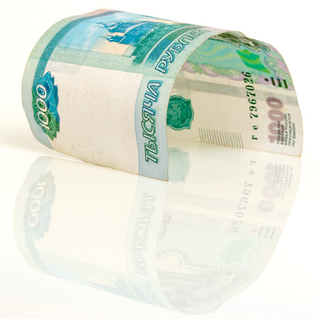 incentives: One banknote thousand russian rubles, on a light background. Stock Photo