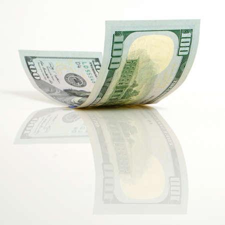 Gebogen honderd dollar bill close-up op een licht vliegtuig. Stockfoto - 35759265