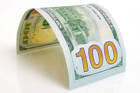 Gebogen honderd dollar bill close-up op een licht vliegtuig. Stockfoto - 35759344