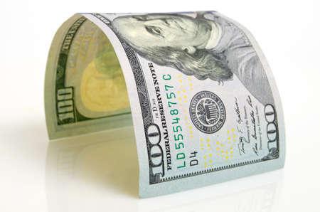 Gebogen honderd dollar bill close-up op een licht vliegtuig. Stockfoto - 35759353