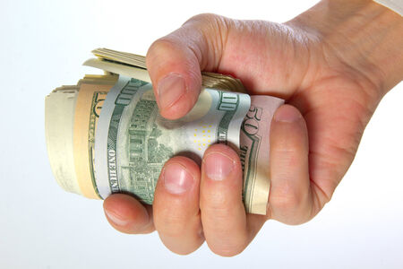 accrual: Cash US dollars in male hand.
