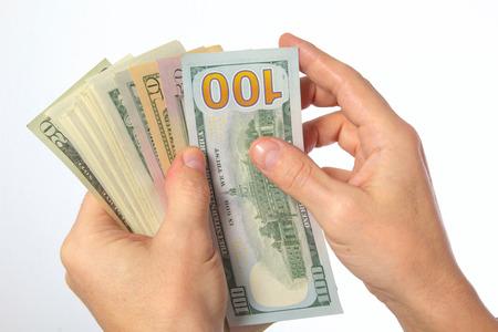 cash money: D�lares estadounidenses en efectivo en la mano masculina.