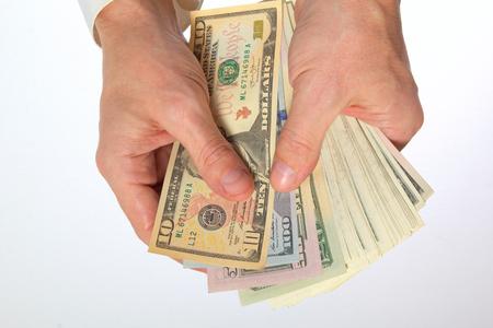 Cash dollar in mannelijke hand.