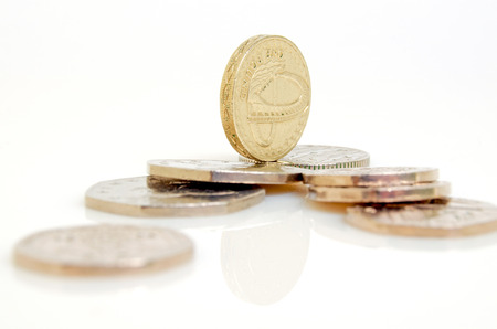 tax tips: Still-life with the British pound and pence.