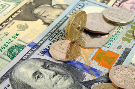 pence: Still-life with the British pound and pence and the US dollar. Stock Photo