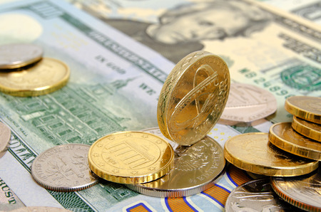 cashing: Still-life with the British pound and pence and the US dollar. Stock Photo