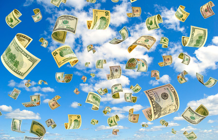 accrual: Dollars fly in the blue sky. Stock Photo