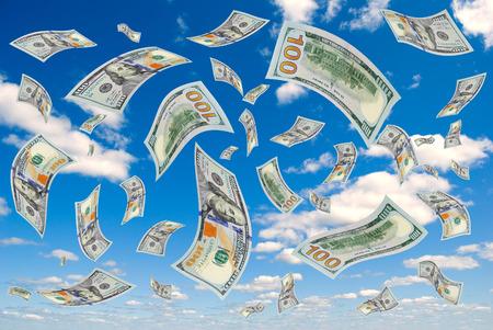 accrual: Hundred-dollar bills flying in the sky.