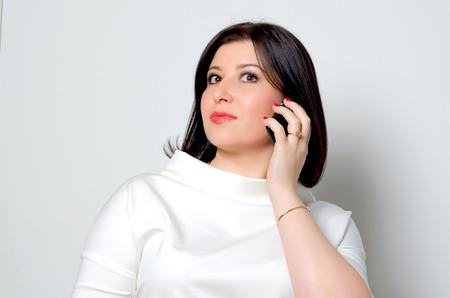 Woman talking on a mobile phone. Stock fotó