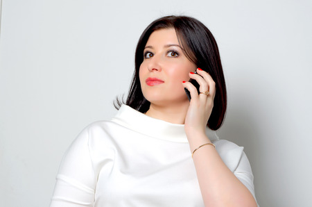 caller: Woman talking on a mobile phone. Stock Photo