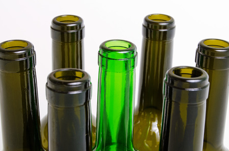 botellas vacias: Empty bottles of wine on a light background.