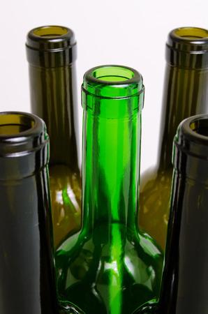 botellas vacias: Empty bottles of wine on a light background.