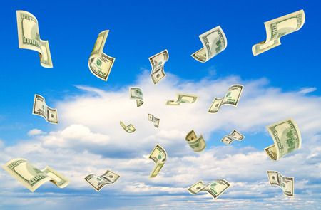 accrual: Dollars falling from the blue sky. Stock Photo