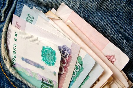 Money in the pocket of blue jeans. Stock Photo