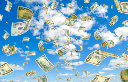 accrual: Dollars are flying in the sky. Stock Photo