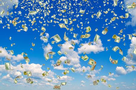 dividends: Hundreddollar bills on a blue sky background.