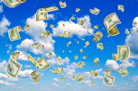 transfer pricing: Hundreddollar bills on a blue sky background.