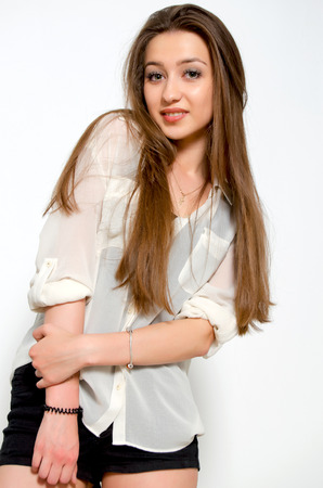 bashfulness: Beautiful young girl with long hair.