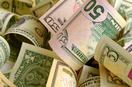 money notes: Cash dollars lying on the plane. Stock Photo