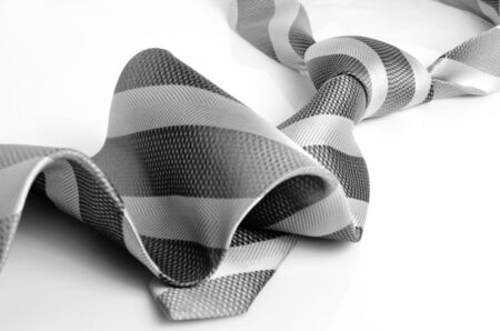dresscode: Wide tie with diagonal stripe on a light background.