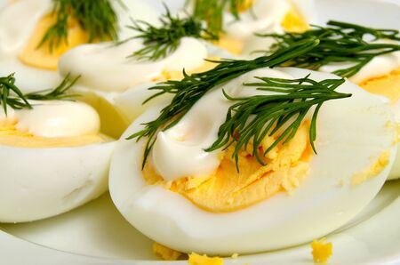 Boiled eggs with mayonnaise and dill, close-up. Reklamní fotografie