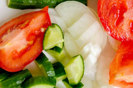 and cellulose: Preparation of salad from fresh cucumbers and tomatoes.