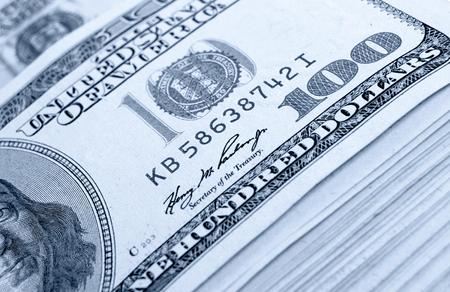 efectivo: Una gran cantidad de dinero en efectivo de dólares. Foto de archivo