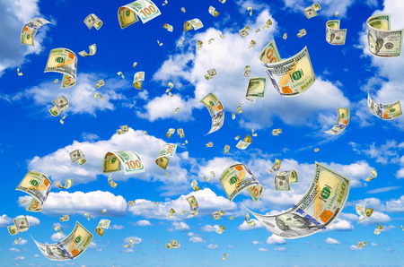 transfer pricing: Hundred dollar bills on a blue sky background. Stock Photo
