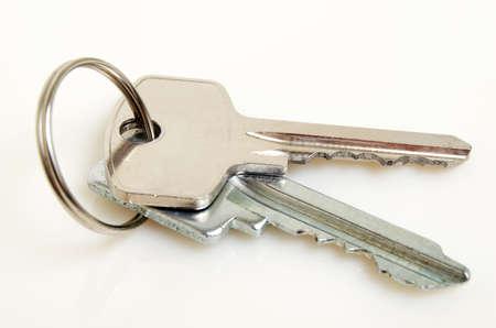 Bunch of keys on a light background. Stock Photo