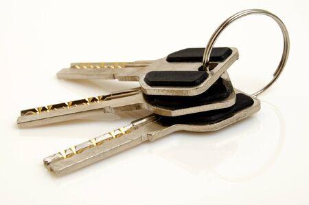 Bunch of keys on a light background. Imagens