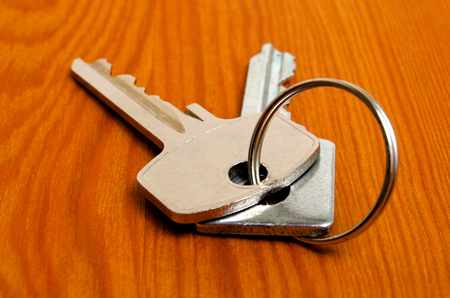 key: Bunch of keys on a wooden texture. Stock Photo