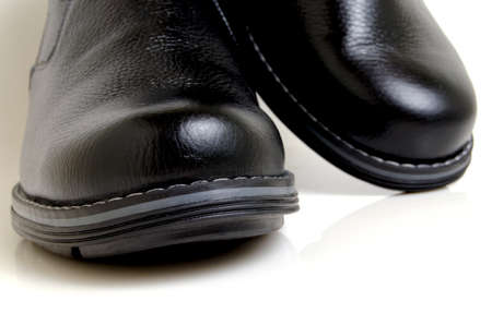 blacking: Hard, stitched shoes of coarse leather, black.